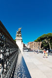 Lattice fence and a statue of the monument to Victor Emmanuel I Stock Photography