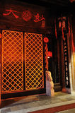 Lattice  gate of Jinli Promenade. A wooden lattice gate,with Chinese palace lantern and stone lion at the door,tyical ancient building of China Stock Photography