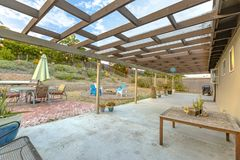 Lattice over a backyard with views of the blue sky and puffy clo. Uds. Wonderful California home in San Diego county. Real estate listings with powerful visuals Royalty Free Stock Photography