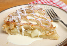 Lattice Pastry Apple Pie Slice with Cream Stock Photo