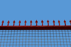 Lattice with peaks against the sky female college fence Royalty Free Stock Images