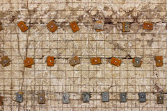 Lattice  reinforced concrete wall with metal washers and bolts Royalty Free Stock Photos