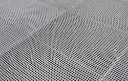 Lattice on the sidewalk. Street airing for the metro. Close-up Royalty Free Stock Photography