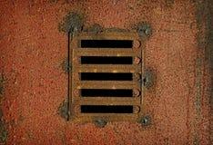 Lattice on steel rusty wall - background Royalty Free Stock Photo