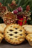 Lattice top mince pie and some christmas decorations Royalty Free Stock Images