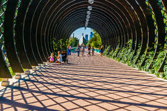 Lattice tunnel entrance to the pedestrian Andreevsky bridge over Royalty Free Stock Photo
