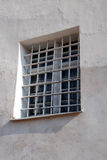 Lattice window. On the old stone wall stock photos