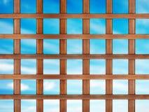 Lattice. Wooden lattice on blue sky background stock photos