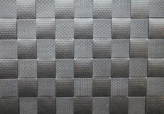 Background of Black Plastic Strips Interwoven in a Lattice Pattern. A lattice work of interwoven black plastic textured strips forms a pattern for use as a Royalty Free Stock Photos
