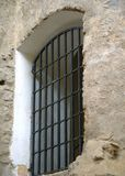 Latticed old window in rough concrete wall Stock Photos