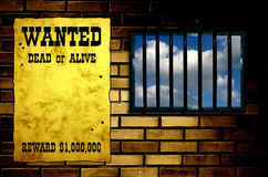 Latticed prison window. Clear sky beyond. Vintage Wanted poster on the wall Royalty Free Stock Photos