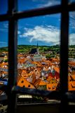 A Latticed View of the Church of St. Vitus and Roofs in Cesky Krumlov stock images