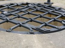 Latticed water well iron cover Stock Image