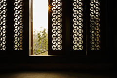 Latticed windows in afternoon sunlight Royalty Free Stock Image