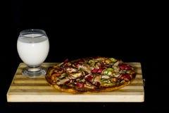 latticello e pizza Immagine Stock