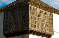 Latticework bakcony. Traditional architecture in of the famous city Cordoba in Spain. Wooden  latticework Balcony Cordoba, Andalusia, Spain Stock Image