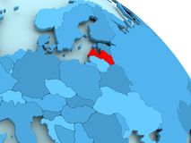 Latvia on blue globe. Latvia highlighted on blue 3D model of political globe. 3D illustration Royalty Free Stock Images