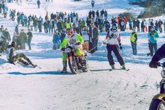 Winter race with mortcycles. Fast engins and big power. Latvia, City Cesis. Winter Red Bull motorcycle race. Snow, Red bull command and drivers. 2015 december royalty free stock photos