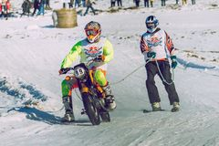 Winter race with mortcycles. Fast engins and big power. Latvia, City Cesis. Winter Red Bull motorcycle race. Snow, Red bull command and drivers. 2015 december stock photography