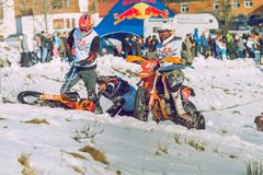 Winter race with mortcycles. Fast engins and big power. Latvia, City Cesis. Winter Red Bull motorcycle race. Snow, Red bull command and drivers. 2015 december royalty free stock image