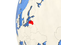 Latvia on 3D globe. Map of Latvia on globe with watery blue oceans and landmass with visible country borders. 3D illustration Royalty Free Stock Images