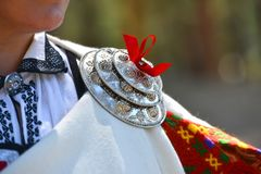 Latvia, details of Rucava folk costume. With ouch, various national patterns depicted on clothing royalty free stock photos