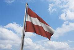 Latvia Flag with Clouds Stock Photography