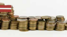 Latvia flag with stack of money coins. Latvia flag waving with stack of money coins stock footage
