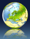 Latvia on globe with reflection. Illustration with detailed planet surface. Elements of this image furnished by NASA Royalty Free Stock Images