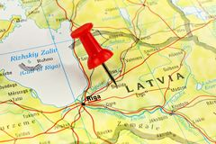 Latvia map with pin. Close up of Riga Latvia on a map with red pin royalty free stock photography