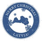Latvia map. Vintage Merry Christmas Latvia Stamp. Stylised rubber stamp with county map and Merry Christmas text, vector illustration Stock Images