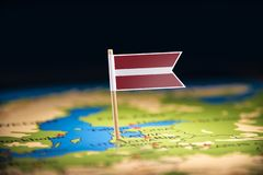 Latvia marked with a flag on the map.  stock image
