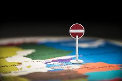 Latvia marked with a flag on the map.  stock photography