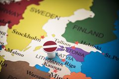 Latvia marked with a flag on the map.  royalty free stock images