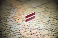 Latvia marked with a flag on the map.  royalty free stock photo