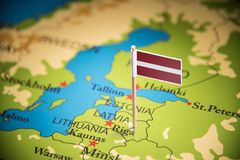 Latvia marked with a flag on the map.  royalty free stock photos