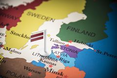 Latvia marked with a flag on the map.  royalty free stock image