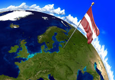 Latvia national flag marking the country location on world map. 3D rendering, parts of this image furnished by NASA Stock Image