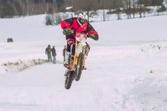 Latvia, Raiskums, Winter motocross, Driver with motorcycle, race. 2013 Stock Photography