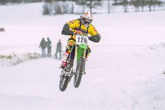 Latvia, Raiskums, Winter motocross, Driver with motorcycle, race. 2013 Stock Images