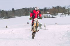 Latvia, Raiskums, Winter motocross, Driver with motorcycle, race. 2013 Royalty Free Stock Image