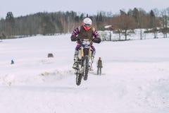 Latvia, Raiskums, Winter motocross, Driver with motorcycle, race. 2013 Royalty Free Stock Photos