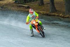 Latvia, Raiskums, Winter motocross, Driver with motorcycle, race. Lake. 2015 Royalty Free Stock Photos