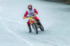 Latvia, Raiskums, Winter motocross, Driver with motorcycle, race. Lake. 2015 Stock Images