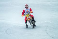Latvia, Raiskums, Winter motocross, Driver with motorcycle, race. Lake. 2015 Stock Photo