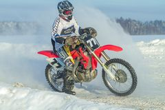 Latvia, Raiskums, Winter motocross, Driver with motorcycle, race Stock Image