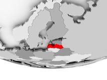 Map of Latvia on grey political globe. Latvia in red on grey political globe. 3D illustration Stock Photo
