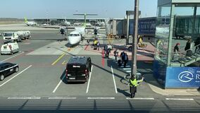Latvia, Riga, 23 April 2019: Time-lapse of boarding passengers from the plane of Air Baltic airlines, Passengers go on