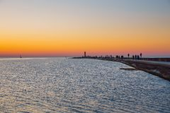 Latvia, Riga, Baltic sea, sunset, mole and wave. 2017 Royalty Free Stock Image