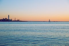 Latvia, Riga, Baltic sea, sunset, mole and wave. 2017 Royalty Free Stock Photos